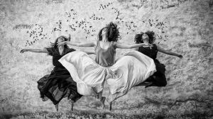We are spiritual beings having a human experience, Three women jump in the air